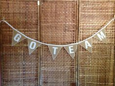 A personal favorite from my Etsy shop https://www.etsy.com/listing/160885200/go-team-natural-burlap-bunting-with-7