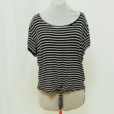 B/W Tie Front Top by Cha Cha Venti Very soft black and white stripe cotton, great feel, tie front. Size XL.  Ask for bundle with black velvet slip on shoes and/or classic black clutch by The Gap.  Gently used in good condition. Cha Cha Venti Tops Blouses