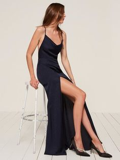 RICH. This is a floor length dress with a cowl neck and cross-back straps.