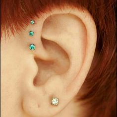 bornthiswaybodyarts:    @aprilthisway snapped this beautiful picture of a triple forward helix piercing project by Bryan Thomas. I love the way the color of the gems contrasts with the color of her hair!