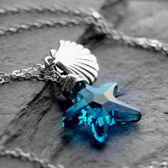 Swarovski Crystal Necklace, Sterling Silver Wire Wrapped Blue Starfish Crystal Pendant, Seashell Charm. $45.00, via Etsy.