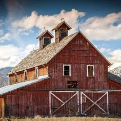 FARMHOUSE – BARN – vintage early american barn commonly used for storing farm equipment, storage of harvested crops, or providing shelter for livestock.