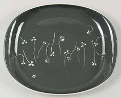 A serving platter in the White Clover pattern in Charcoal by Russell Wright.  Grew up with these dishes in the Meadow Green color.