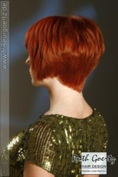 Angled bob with layers and a graduated nape. Red hair.