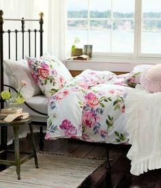 Cottage chic bedroom...pretty floral bedding. Whimsical Raindrop Cottage