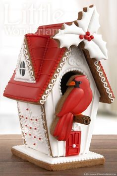 Gingerbread house with Red Cardinal Cookie resting on Cinnamon Stick!!!