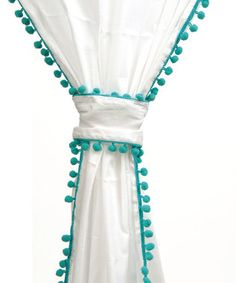 Curtains with turquoise pom poms