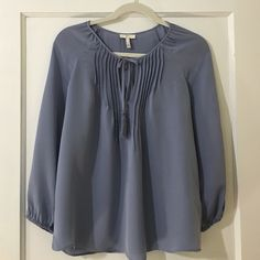 Gorgeous Joie Silk Blouse Gorgeous Joie Silk Blouse. Size X-Small (may small measures approximately 18 and 1/2 inches lying flat across the chest. Blue. Long Sleeves. 100% Silk. In good preowned condition. Please feel free to ask any questions or request measurements. Thanks for looking! Joie Tops Blouses