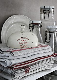 love this stack of linens and the old jars!