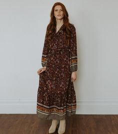 """Model is 5'10 wearing size SMALL  Burnt red boho dress with neck tie and small clasp at the v, slip lined to the knee  Is meant to be a loose oversize style fit (even in the bust area)  Exact Sizing Below:  S: Length: 55"""", Waist - 28"""", Bust - 32"""", Arms - 14""""  M: Length: 55"""", Waist - 30"""", Bust - 34"""", Arms - 15""""  L: Length: 55"""", Waist - 32"""", Bust - 36"""", Arms - 16"""""""
