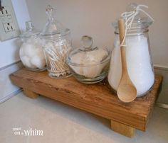 Glass Apothecary Jars on Wooden Riser | Vintage Farmhouse Bathroom Makeover | Denise on a Whim