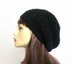 This is made to order. Please check my shipping times under the shipping button before ordering.  This beanie is slouchy. I crocheted it with black thick acrylic yarn. It is stretchy and will fit most teens or adults, men or women. It will fit anywhere on your head and has a large enough slouch to tuck lots of hair. It is very simple but classy. This hat is made to order. If you would like a different color please let me know.   Hand wash is recommended.