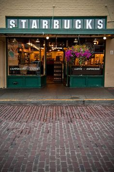 The very first original Starbucks | Pike's Place Market, Seattle This picture had to be taken at 4:30 am right after the sun comes up because there is no one in site. This place is always crowded to the street and has street musicians outside.