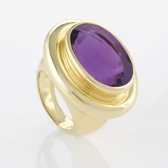 A Faceted Oval Amethyst Quartz ring by Paloma Picasso for Tiffany & Co.  An 18 karat gold faceted oval amethyst quartz ring by Paloma Picasso for Tiffany & Co. The amethyst has an approximate total weight of 20.55cts. 1980s