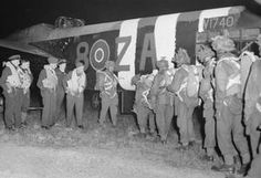 Paratroops of 6th Airborne Division climbing into an RAF Albemarle aircraft at RAF Harwell, 5 June 1944.