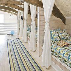 bunk room, planked walls, loose drapes, beams...dreamy escape.