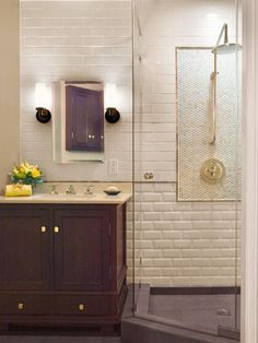 Small Bathrooms That Pack a Punch: By keeping a light and cohesive color scheme, the various textures in this bathroom add subtle interest for major impact. From DIYnetwork.com