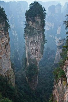 Somewhere someone thought hey lets climb this crazy rock n carve something crazy huge !