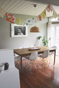 The bunting gives this room a fun touch...but I love this table paired with these chairs!