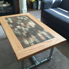 This commissioned coffee table is finally home! It is made of oak around the perimeter, 2x4 blocks in the center, dyed epoxy resin to fill in the gaps and accentuate the end grain, and galvanized pipe legs.