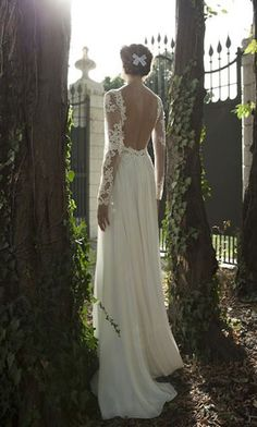 I love the lace sleeves and the open back..