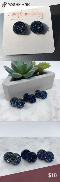 Metalic Blue Druzy Stone Studs Metalic blue faux druzy stones in 12mm gunmetal settings.  Comes with plastic earring backs and on earring cards.  Handmade in El Paso, TX Simple Sanctuary Jewelry Earrings