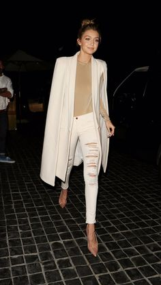 Click here to see best white ripped skinny jeans like Gigi Hadid wears: http://www.slant.co/topics/5078/~ripped-white-skinny-jeans
