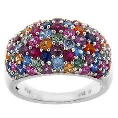 Add a punch of color to the finger with the Sterling Silver Multi-Color Gemstone Cluster Ring. Resting atop a smooth sterling silver band is a cluster of colorful gemstones shapes. The round prong-set stones are displayed in no particular pattern creating a unique look and showcasing wonderful shine that will go with any outfit. This cocktail ring is 3.05-millimeters wide...