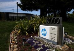 A sign is posted outside of the Hewlett-Packard headquarters on May 23, 2014 in Palo Alto, California. HP announced is splitting into two different companies. (Justin Sullivan/Getty Images)