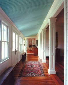 Love the blue ceiling in this entry hallway.