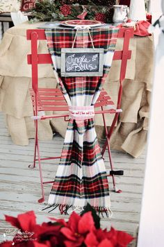 Another pinner says: Jingle bell chalk sign, christmas chalk sign, plaid scarf chair decor, red steel Kmart chair. I like the idea of using a scarf as decor on back of chair. Christmas Chair, Tartan Christmas, Country Christmas, Outdoor Christmas, Christmas And New Year, Christmas Home, Christmas Ideas, Merry Christmas, Christmas Kitchen
