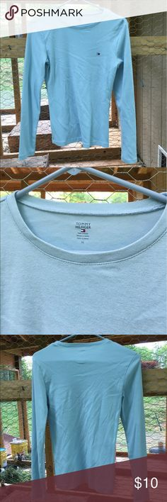 Tommy Hilfiger Light Blue Long Sleeves Tee Medium Tommy Hilfiger women's light blue long sleeves tee is size medium. Tee has Embroidered emblem on front. Close up pic shows the correct color. Made in Vietnam. Material tag was cut off. Tommy Hilfiger Tops Tees - Long Sleeve