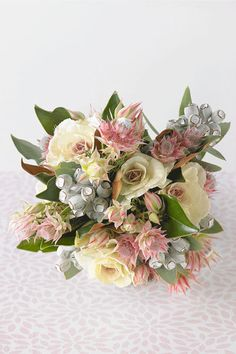 Unstructured posy of blushing bride, tetragona nuts, white kale and magnolia foliage. Available in spring from Plumbago Flowers. Bridal Flowers, Silk Flowers, Wedding Flower Design, Australian Native Flowers, May Weddings, Flowers For You, Bride Bouquets, Flower Designs, Floral Arrangements