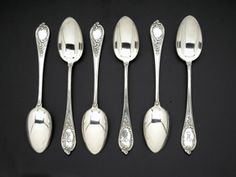 A Collection of Silver Teaspoons, Faberge, Moscow, circa 1910 comprised of six spoons, each designed with a handle formed as a rococo cartouche decorated by scrolling acanthus leaves, engraved with Russian monogram, PE, with Faberge initials, assay and 84 standard mark.