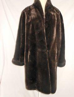 Faux Fur Vintage 80s Swing Short Coat Long Jacket Steve Searle New Old Stock  Luxurious Dead Stock Oversize S by backtocapri on Etsy https://www.etsy.com/listing/172966819/faux-fur-vintage-80s-swing-short-coat