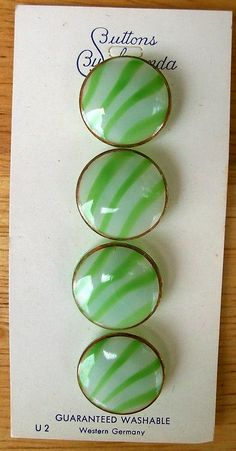 Green and white striped moonglow Schwanda buttons, Western Germany.