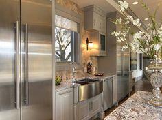 Pretty light gray cabinetry and White Diamonds granite.