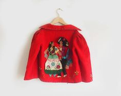 A little something to spice up your little ones wardrobe. MADE IN MEXICO   - hand embroidered folk art  - wool blend  MEASUREMENTS:  - shoulders: 13  - armpit to armpit: 15 - sleeve: 16  Condition: A few embroidered pieces are coming undone and some loose stitching around the hems.