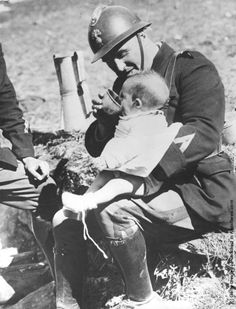 A soldier in the French Frontier Troops feeding one of the Spanish refugee babies who had crossed the border from Spain during the Spanish Civil War. Enlarge  http://pix.avaxnews.com/avaxnews/87/1f/00001f87_big.jpeg