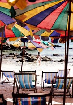What a great shot - would love to sit under one of those umbrellas! #summerholiday #sunburn #shadesunprotect