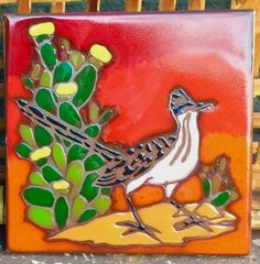 = Roadrunner Strikes a Pose on a Desert Boho 6 Inch Red Art Tile = Bohemian Modern Kitchen Decor = Tall Flowering Yellow Prickly Pear Cactus = Colorful Desert Art Tile = Roadrunner and Cactus Flowers = 6 x 6 x 3/8  = Excellent condition = Please zoom in on photos for best viewing  = Ships within 3 business days or less = Shipping overcharges of a dollar & more are cheerfully refunded = Thank you ♥  = Follow on Instagram @InO...