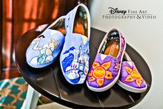 What's better than a pair of Cinderella-inspired TOMS? A pair of Cinderella-inspired TOMS and a pair of Rapunzel-inspired ones!
