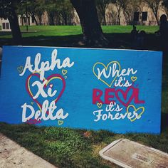 Paint wooden billboards to advertise for events around campus