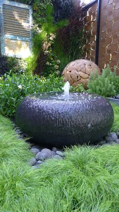 I like this fountain and the soft grasses surrounding it.