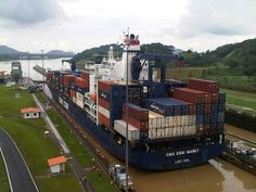 Cargo Ship crossing the Miraflores Locks, Panam Canal. The average ship can carry 2000 containers.