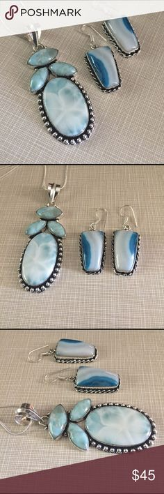 Beautiful artisan handcrafted set Beautiful artisan handcrafted design set earrings are agate stones nuances of blue stamped inlay 925 approximately 1'1/2'long pendant is lab created larimar also stamped 925 approximately 3'long 19 grams main gemstone 22x33mm beautifully made with chain approximately 18'long nwot Jewelry Necklaces