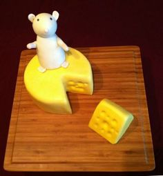 Yellow cake with cream cheese filling, buttercream icing, marshmallow fondant enrobing. Fondant and gumpaste mouse.