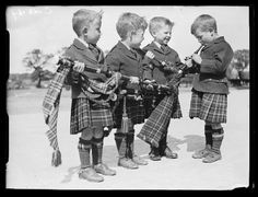 Four boys with bagpipes attending the meeting of the Scottish Clans, held in London, 1933, photo by George Woodbine for the Daily Herald (via the National Media Museum UK/Daily Herald Archive)