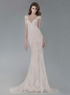 Victoria KyriaKides blush trumpet style wedding dress with detailed lace appliques and cap sleeves Fall 2016 | https://www.theknot.com/content/victoria-kyriakides-wedding-dresses-bridal-fashion-week-fall-2016