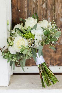 Elegant white and green bouquet. View the full wedding here: http://thedailywedding.com/2016/06/27/dazzling-rustic-barn-wedding-alyssa-josh/